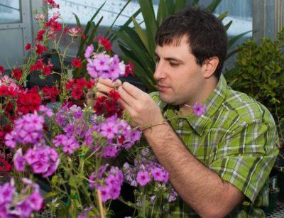 James examining flower petals